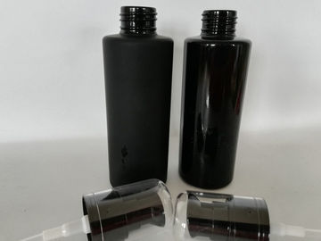 China Customized Logo Black Cosmetic Bottles For Lotion Moisturizer Foundation supplier